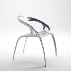 Ross Lovegrove Go Chair - This chair would be great looking around a dinner table outside. The metal version is friendly for the outdoors with a sleek, modern feel. It's a great way to mix up styles putting this with a more traditional wood table.