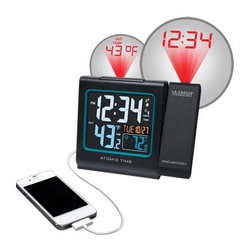 La Crosse Technologies - Atomic Wall Clock Solar Power - Wake up to your weather. Accurate atomic time and date featuring projection onto your ceiling or wall with arm rotation and automatic focus. View your outdoor temperature and/or alternating time along with alarm features and display of indoor temperature (F/C). Has LCD backlight and includes ac adapter and wireless outdoor temperature sensor that transmits within 200 ft. This item cannot be shipped to APO/FPO addresses. Please accept our apologies.