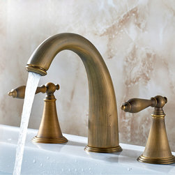 Suex Antique Brass Widespread Sink Faucet - Old world styling and handsome details are hallmarks of this classic Suex double handle widespread bathroom sink faucet that is sure to add a spot of English charm to any bathroom. Constructed from solid brass for durability and reliability, finished in antique brass.