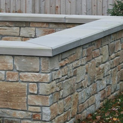 Rustic Ridge Veneer Retaining Wall - In a family of stone already notorious for its character, Rustic Ridge takes the dramatic rustic look to the next level. Available in a stunning array of rich colors, including gold and rust, and boasting some imposing stratification, this stone insists on being the center of attention. When it comes to making a statement, few stones can compete with Rustic Ridge