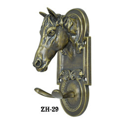 Vintage Style Hooks, Shelves, and Brackets - This hook has wonderful detail, with the quality of a miniature bronze.  Copyright by Vintage Hardware 2001.
