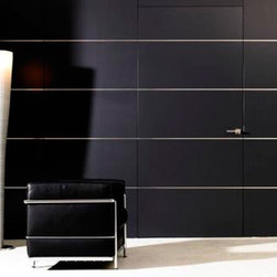 Hidden Doors - Invisible doors provide a clean look. A great idea to give the appearance of a larger room is by installing these doors. Available in a variety of materials from Europe in your choice of high-gloss or matte finish. Whether you are looking for a door that leads to a secret room, door to fuse with other elements in space, or door and wall paneling to look as one perfect piece, we have the perfect door for you.