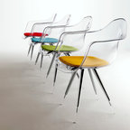 "Angel Armchair by Kubikoff - Angel chair with a basic structure and a very refined simplicity. The combination between the chromium-plated part and the acrylic part of the legs creates a curious ""suspended"" effect, increased by the possible use, for chair and armchair, of a shell in transparent polycarbonate. Seatpads are available in various colors. Also available in leather"