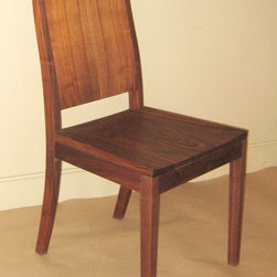 STUDIO SIDE CHAIR - Our dining chairs come in a variety of styles and woods. We have a selection of arm styles to chose from, as well. Many of our chairs come with a carved wood seat option, graded upholstery options, or C.O.M. or C.O.L options as well. Since we build to order, we can adjust the seat height, arm styles and lengths, and seat cushioning to meet your individual needs.
