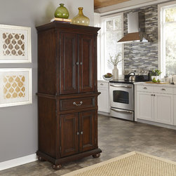 None - Colonial Classic Pantry - The embodiment of elegance,the Colonial Classics Collection by Home Styles provides a sophisticated retreat. Creating the kitchen of your dreams with beautiful craftsmanship of the impressive picture frame moldings and turned bun feet.