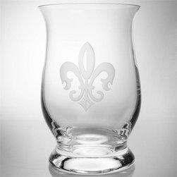 Rolf - Grand Fleur De Lis Etched Hurricane - Place a simple white candle inside this curvy hurricane lamp and softly illuminate the living room. Tailored and serene, the Grand Fleur De Lis Hurricane Candle Holder, etched with the French-inspired taste, brings glamour to your dining table. When they aren't providing candle glow, fill them with flowers or collections or interesting objects.