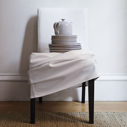 Porter Dining Chair Slipcovers - The quickest, easiest way to give your dining room a fresh, new look. Offered in a playful assortment of prints and solids to mix, match and change with the seasons, as you please.