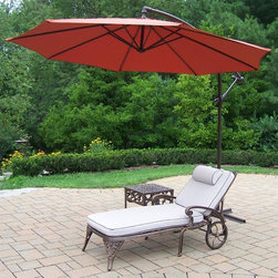 Oakland Living - 3-Pc Outdoor Traditional Chaise Lounge Set - Includes chaise lounge with cushion, side table and 10 ft. cantilever umbrella. Metal hardware. Lightweight. Fade, chip and crack resistant. Warranty: One year limited. Made from rust free cast aluminum. Antique bronze hardened powder coat finish. Minimal assembly required. End table: 17.5 in. W x 17.5 in. D x 19 in. H (15 lbs.). Chaise: 71 in. W x 25.5 in. D x 35 in. H (68 lbs.). Overall weight: 158 lbs.This Chaise lounger set will be a beautiful addition to your patio, balcony or outdoor entertainment area. Our Chaise lounger sets are perfect for any small space, or to accent a larger space. We recommend that the products be covered to protect them when not in use. To preserve the beauty and finish of the metal products, we recommend applying an epoxy clear coat once a year. However, because of the nature of iron it will eventually rust when exposed to the elements. The Oakland Elite Collection combines old world charm and modern designs giving you a rich addition to any outdoor setting. The traditional lattice pattern is crisp and stylish. Each piece is hand cast and finished for the highest quality possible.