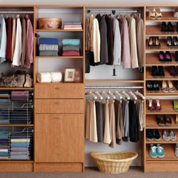Reach-In Closets - Reach-in closets with shoe racks and tilt out hampers help organize your life.