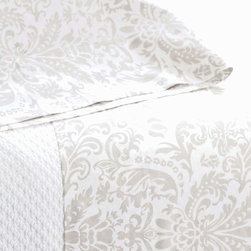 Genevieve Sheet Set - Layer detail into the look of a bedroom by starting with the lacy outlines and dramatic dual-tone pattern of the Genevieve Sheet Set, which uses a traditional European-inspired damask print on 200-thread-count cotton to lend a sense of savoir faire and old-world taste to your bedding.  Incorporate the cotton sheets into an elegant array of linens and throw pillows for detail-conscious style.