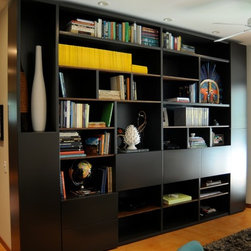 Modern Bookcase - Modern storage solution with shelving, closed storage, and drop down workstations.