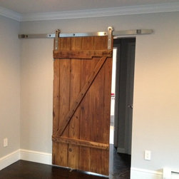 Reclaimed Barn Door Design Ideas from Projects in NYC, New Jersey & Connecticut - Reclaimed Barn Door - Salvaged and Reused as an Interior Door