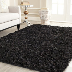 Safavieh - Safavieh Handmade Metro Black Suede Leather Metro Shag (5' x 8') - Modernize any preconceived notions of a shag carpet with this leather black shag rug. This rug will give character to any room in the house,and your feet will give thanks when walking on the lush,one-inch layer of hand-woven suede.