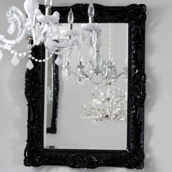 ruffle edge mirror in black - This mirror looks like you found some dusty ornate Victorian mirror in Granny's attic and brought it up to date by cleaning it up and painting it with high gloss paint. The thing is, you don't have to bother with all that trouble; just buy this fabulous one from Brocade Home instead.