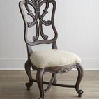 "Horchow - Two Donabella Wood-Back Side Chairs - This chair features a stunning frame with intricately carved back, providing a beautiful silhouette from any angle. Carvings detailing the outlines of the legs add a dramatic dimension to this seating option. Mixed hardwood frame. Polyester upholstery. Sold in pairs; each, 23.5""W x 28""D x 46""T."