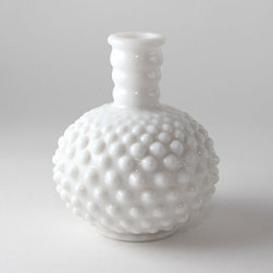 Milk Glass Vase by The Vintage Daughter - Originally used as a perfume decanter, this tiny 5-inch-tall milk glass piece would look great as a bud vase or simply used for display. I can see it as part of a pretty still life on a table or mantelpiece.