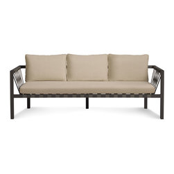 Blu Dot - Blu Dot Jibe 3 Seat Outdoor Sofa, Carbon / Sunbrella Taupe - A beefy grey powder-coated aluminum frame, nylon support straps, and anti-microbial foam upholstered in resilient Sunbrella fabric team up to make an outdoor seating solution.Powder-coated aluminum frame, Sunbrella fabric, Nylon support straps, Mildew resistant poly foam
