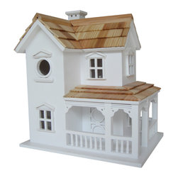 Home Bazaar Inc. - Prairie Farmhouse Birdhouse - This two-story house features a classic rocking chair porch, window and door moldings and a pine shingled roof. Comes equipped with a mounting bracket to be able to put the house on a post or tree or a fence. A 1 1/4 � opening will allow wrens, finches, chickadees and nuthatches to nest. Constructed of exterior grade ply-board, polyresin details, pine shingles for the roof and an outdoor, water-based, non-toxic paint.
