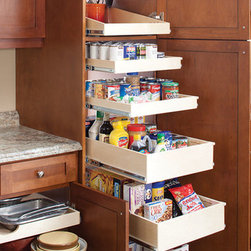 Pantry - Single and double height Glide-Out shelves created a dream pantry for our happy homeowner. Deeper, double height Glide-Out shelves at the bottom allow for easy storage of taller items that frequently tip over. Glide-Out shelves maximize the options in this pantry.