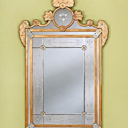 """Venetian Gems - Sherine Venetian Wall Mirror - Infuse royal elegance into your home dcor with the beautiful Sherine Venetian Wall Mirror. Crafted using old techniques from Venice, Italy, this hand-etched wall mirror boasts a lovely frame with gold accents and top adornments. The included hanger allows for easy mounting. Wall Mirror Features: -Venetian rectangular wall mirror. -Hand-etched frame with gold details. -Hand-cut glass. -Wood backing. -Equipped for easy wall mounting. -Overall dimensions: 52"""" H x 32"""" W."""
