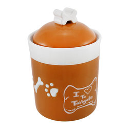 Zeckos - Comical I Love To Tailgate Orange/White Dog Treat Jar - This comical dog treat jar expresses a dog's passion for a rather smelly type of communication with the sentiment 'I Love to Tailgate' printed on the side. Measuring 7 1/2 inches tall with a 5 inch diameter, this cute jar can hold a decent number of your dog's favorite treat. The ceramic jar has a glossy orange finish with a white trim and white dog paws and bones engraved around the center. The orange lid, topped with a white bone-shaped handle, features a plastic seal that will keep Spot's treats fresh. Guests will admire this funny doggy jar and your dog will be tailgating you for another treat.