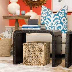 Heavy Metal Side Table - With tactile round studs on its edges and a lacquered finish, this charcoal iron and steel side table is edgy and enigmatic — a rockstar in a tuxedo. This heavy item is as solid as they come. Make a great spot to prop up your feet or hold a tray of wobbly cocktails.