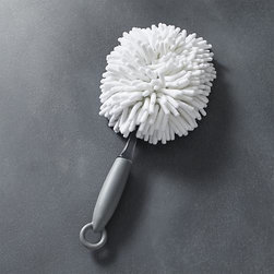 Casabella® White Hand Duster - Designed just for us by Casabella, this modern hand duster features a unique, microfiber looped head that lures and traps the dust that collects on furniture, bookshelves, knickknacks and other surfaces. Comfortable looped rubber handle makes it easy to store when not in use.