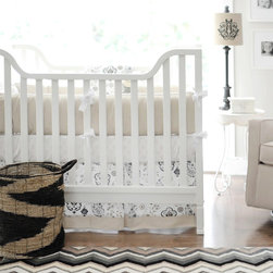 New Arrivals - New Arrivals Crib Bedding Penelope Wheat - Reflecting the whimsy and joy of life, New Arrivals delivers fun and function to a child's room. The Penelope Wheat crib bedding soothes with a unique range of artistic medallions in brown, ash gray, charcoal and white. This neutral sheet, skirt, receiving blanket and bumper collection offers sets of two, three or four coordinating pieces. Optional changing pad cover, curtain panel set, boudoir pillow and bumper monogramming are available. Handmade in the USA.