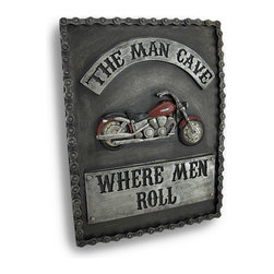 Zeckos - Man Cave, Where Men Roll Motorcycle Wall Plaque - This wall plaque features a cruiser style motorcycle, with 'The Man Cave' etched above the motorcycle, and ''Where Men Roll' below. Made of cold cast resin, the plaque has a metallic gray finish to give it the look of raw iron, and has a motorcycle chain frame edge. It measures 12 inches by 9 inches, and is about an inch thick. It easily mounts to the wall with a single nail or screw by the reinforced keyhole hanger on the back. It makes a great addition to any 'Man Cave'.