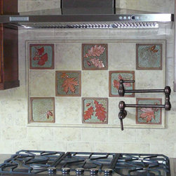 Kitchen backsplash with  Fay Jones Day Tile - Focal point above stove in the Wong kitchen. Handmade accent tiles combined with marble tile.