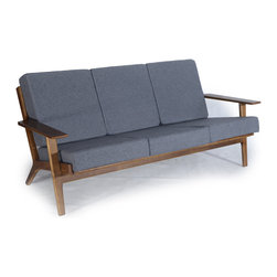 Kardiel Hans J Wegner Style Plank Sofa, Cadet Grey Cashmere/Dark Wood - The year of design was 1953. Hans Wegner created the GE 290 Plank Series with a wind swept lineal frame. Similar to the wing chair, the frame of the plank series is pitched backward in angle in such a way that one can imagine the series being produced in a wind tunnel. The look denotes the forward thinking, forward direction Series GE 290 design. In previous designs, Hans had created single pieces. The notable element of the Plank series was the 1, 2 and 3 seat configuration as options. Hans is no doubt the father of Danish Modern Furniture design. This series shows his desire to incorporate wood as is present in much of the Danish designs with wool upholstery for its practical comfort. This series graduated to design icon status throughout Europe, the U.K and Australia by the mid 1970's. Its popularity in the U.S is now on the rise, however on a positive note, it is not a design that is known to the masses. Ownership of this series still has the advantage of exclusivity to it as it denotes a deeper understanding of the Mid-Century Designs and their designers.