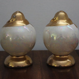 Vintage Glass Pearlescent Salt & Pepper Shaker Set by Things & Stuff You Need - Throwing in some vintage pieces is a great way to create visual interest and variety in your home. Using these vintage pearly glass salt and pepper shakers with some new dishes and glassware would be a great look.