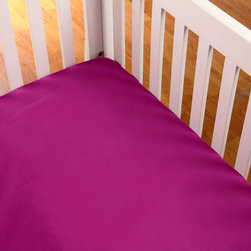 "Terrific Tie Dye - Purple Crib Sheet - Be one of a kind with our  bold and beautiful collection ""Terrific Tie Dye"".  Crib sheet in the collections solid purple cotton fabric."