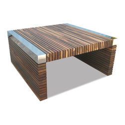 Argilla Table - From the Italian word for clay, this table features slats of responsibly harvested exotic solid wood from Argentina and nickel plated metal corner blocks. Shown in Guayubira, natural semi-gloss finish. Available in several wood species, any finish, and for shipment anywhere in the world.