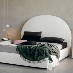 Cattelan Italia - Cattelan Italia | Bjorn Bed - Made in Italy by Cattelan Italia.The Bjorn Bed elevates the meaning of luxury and comfort by combining the opulence of fine soft leathers with the integrity of premium timber into its modest design. A simple styled, wide dome-shaped headboard gives the piece a softened look and feel while providing sturdy support. Enhancing the coziness factor of the bed is ample all-around padding under the leather upholstery. The bed also comes in several sizes and with an option for under bed storage (pull up slats) for keeping bedroom essentials. Choose from various leather colors and textures to create a relaxing ambiance that fits with your décor. Made in Italy. Mattress not included.