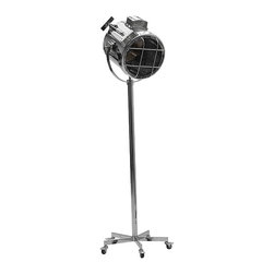 Kathy Kuo Home - Spike Hollywood Regency Cinema Retro Silver Searchlight Castors Floor Lamp - Shine a spotlight on your industrial loft décor with this Hollywood movie production style floor lamp.  A modern, gleaming chrome finish gives this oversized searchlight a classy touch, and it rolls on casters for maximum usefulness.  Place this in your retro home next to stacks of Motown vinyl and your hip factor will instantly soar.
