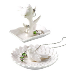 Bird Jewelry Holder, Set of 2 - Sweetly serene, the Lady Bird Jewelry Holder comes with two small white porcelain dishes to hold your rings and bracelets, each with its own distinctive design that subtly integrates into your decor. Perch one on your vanity and one by your bathroom sink or perhaps give one as a thoughtful gift and keep one for yourself as they both will arrive in individual gift boxes.