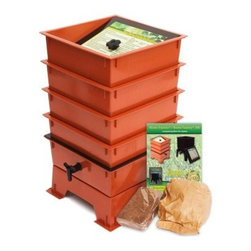 """The Worm Factory® 4-Tray Worm Composter - Terra Cotta - Additional featuresUse indoors during winter and outdoors summerCan house 6 000 worms (not included) that consume 5-8 lbs. of food per weekApproximate weight is 14 lbs.5 year warranty on parts and workmanshipRecycles kitchen waste and junk mail into nutrient-rich compost What is The Worm Factory 4-Tray Worm Composter - Terra Cotta and how does it work?The Worm Factory is a multi-tray worm composter that helps manage the composting process. Fill each stacking tray with kitchen scraps such as newspaper junk mail vegetables fruits egg shells coffee grounds paper and cardboard into nutrient-rich compost for your garden. Most """"Master Gardeners"""" consider worm castings to be the very best compost available. Your plants will thrive with this all-natural compost. Sorting out the undigested scraps can be a messy inconvenient chore with ordinary worm composters.Worms start in the bottom tray and migrate upward as they break down the waste. This allows worms to separate themselves from the finished compost making it easy to add nutrient-rich fertilizer to plants and gardens without sorting worms. Additionally nutrient-rich moisture is captured in the collection tray and can be drained as liquid fertilizer known as """"worm tea"""".What are the benefits of using The Worm Factory?The Worm Factory is Compact:With its square design and having the smallest footprint of all the worm composters The Worm Factory works great for anyone with space requirements. The Worm Factory uses a tray stacking system which allows it to hold the largest capacity of compost in the smallest amount of space.The Worm Factory is Odorless:The ventilation lid allows proper air flow and the instruction manual helps you manage The Worm Factory correctly to prevent odor. This means that The Worm Factory can be used year round and can be housed anywhere including apartments kitchens garages porches etc.The Worm Factory is Easy to Manage:The 16 page instruction m"""
