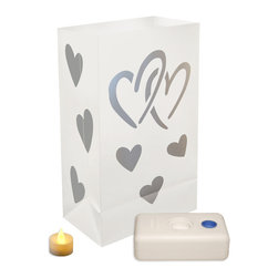 LumaBase Luminarias - Battery Operated Luminaria Kit Hearts - Battery operated luminarias will create festive lighting for your special event. The luminarias are weather resistant, reusable and can be used indoors or outdoors. The LumaBase is a water weighted base that will anchor the bag and hold the battery operated tea light secure. For outdoor use only. Included: 12 Plastic Bags, 12 Battery Operated Tea Light Candles (batteries included), 12 LumaBases