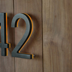 """Illuminated Bronze House Numbers 8"""" - Outdoor LED Backlit  Luxello - The Bronze 8"""" inch LED Illuminated House Numbers. The numbers are finished is an anodized oil rubbed bronze color with an illuminated white or amber edge. These bronze LED House number are IP 44 rated and suitable for residential and commercial sign applications."""