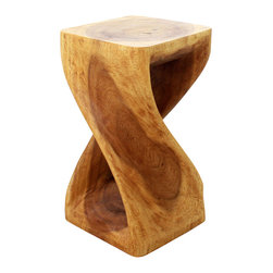 Kammika - Monkey Pod Wood Twist Stool - Our Sustainable Monkey Pod Wood Twist Stool 10 inch x 10 inch x 18 inch height with Eco Friendly, Natural, Food-safe Livos Oak Oil Finish is carved from sustainable Monkey Pod wood and is completely eco friendly. The beauty of this design lies in its simplicity. It is bold, yet gentle; rustic yet refined. One quarter twists support this piece, which can serve as an end table, stand or stool; they can serve as a serving table or bench when put together. This versatile piece is solid and reliable; each is hand carved - no two are alike. Craftspeople from the Chiang Mai area in Northern Thailand create these pieces with the simplest of tools. Each piece is a Work of Functional Sustainable Monkey Pod Wood Eco Friendly Art! After each Monkey Pod wood (Acacia, Koa, Rain Tree grown for wood carving) piece is dried, and carved, it is rubbed in Livos Oak oil creating a water resistant and food safe matte finish. The light and dark portions of wood turn to darker shades of brown over time and the alkaline in the oils creates a honey orange color. There is no oily feel, and cannot bleed into carpets. We make minimal use of electric hand sanders in the finishing process. All products are dried in solar or propane kilns. No chemicals are used in the process, ever. This eco friendly piece, made from the thick branches of the quick-growing Acacia tree in Thailand - where each branch is cut and carved to order (allowing the tree to continue growing), is packaged with cartons from recycled cardboard with no plastic or other fillers. As this is a natural product, the color and grain of your piece of Nature will be unique, and may include small checks or cracks that occur when the wood is dried. Sizes are approximate. Products could have visible marks from tools used, patches from small repairs, knot holes, natural inclusions or holes. There may be various separations or cracks on your piece when it arrives. There may be some slight variation in size, color, texture, and finish color.Only listed product included.
