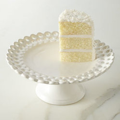 "NM EXCLUSIVE - NM EXCLUSIVE Pierced Footed Cake Stand - Exclusively ours. Pierced, scalloped edges add dimension to these fun dessert plates and footed cake stand. Made of earthenware. Dishwasher and microwave safe. Footed cake stand in white, 11""Dia. x 4.75""T. Set of four assorted dessert plates inclu..."