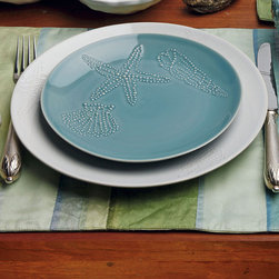 Frontgate - La Playa Set of Four Salad Plates - Handcrafted in northern Portugal by skilled artisans in an environmentally friendly facility. Variations in color are to be expected, due to handmade nature. Also coordinates with our Sardinha collection. Casual dinners conjure seaside daydreams with our La Playa collection of fine Portuguese stoneware. In our La Playa Dinner Plate, the forms of a starfish and two seashells are delicately told in relief over a smooth, hand-painted surface. Each handmade piece is beautifully crafted to go from the oven to the table, freezer or microwave.. . .
