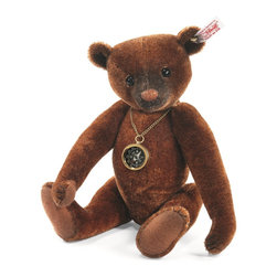 Steiff - Steiff Nando Teddy Bear - You´ll never get lost in Paradise Jungle with Nando by your side. Around his neck, he wears a real operating compass, so you´ll always know which direction you´re headed. Nando is sewn from finest russet tipped batik chestnut mohair - a very unique fabric. He is a showcase of the airbrusher´s art, with painting around his nose, eyes, and ears. Nando´s nose is hand embroidered in chestnut floss framed by black thread. His claws and mouth are also black floss. He´s five-way jointed. Stay on the right course with Nando and you´ll make the most of your time in Paradise Jungle.