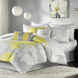 Madison Park Lola Brianna 7 Piece Print Comforter Set - Finish your bedroom with the Madison Park Lola Brianna 7 Piece Print Comforter Set. Available in a variety of great colors, this comforter features an oversized flower design for modern style. It's made of soft cotton and smart polyester, which means these covers will give you many cozy nights. Machine-washable and available in a variety of sizes! You get the comforter, two pillow shams, three decorative pillows, and a bed skirt for a complete look. Perfect for the dorm!Comforter Dimensions:Twin: 68 x 90 in.Queen: 90 x 90 in.King: 104 x 92 in.Calif. King: 104 x 92 in.