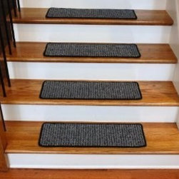 "Dean Flooring Company - Washable Non-Skid Carpet Stair Treads - Silvered Sky (13) - Washable Non-Skid Carpet Stair Treads - Silvered Sky (13) : Washable Non-Skid Carpet Stair Treads by Dean Flooring Company Color: Silvered Sky (Black and Grey) Face: 100% Polypropylene. Backing: Washable Non-Skid Latex Rubber. Edges: Finished (Serged) with Color Matching Yarn. Set includes 13 pieces. Each tread measures approximately 27"" x 9"". Wash on delicate in cold water, line dry. Also easy to spot clean and vacuum. Helps prevent slips on your hardwood stairs. Great for helping your dog easily navigate your slippery staircase. Reduces noise. Reduces wear and tear on your hardwood stairs. Attractive: adds a fresh new look to your staircase. Easy DIY installation with double sided carpet tape (not included). High quality enhanced textured loop patterned 21 oz. stain resistant carpeting. Add a touch of warmth and style to your home today with stair treads from Dean Flooring Company!"