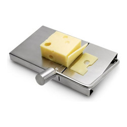 Contemporary Cheese Slicer - Add style to your kitchen with this sleek stainless steel cheese cutter that uses a metal wire to slice the perfect piece of cheese every time. Its clean design and functionality make it a welcome addition to any kitchen. Hand washing recommended. Comes with two wire replacement, refills of five available.