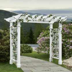 Grandin Road - Fairfield Grande Arbor - Polyvinyl construction will not fade or deteriorate in the elements. Never needs a fresh coat of paint. Spray clean with a garden hose. Complete the look with optional wings and gate. The natural flat-top pergola design of our Fairfield Grande Arbor provides the perfect compliment to any pathway or garden. A larger version of the popular Fairfield style, this garden arbor will stretch over wider pathways with the same complimentary style. Our state-of-the-art garden decor is more durable than wood varieties as its classic white frame will stand up to the abuse of the outdoors.. . . . Assembly required.