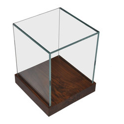Rotsen Furniture - Salvaged Wood and Glass Side Table - This side table is a clear winner. Its transparent glass walls let its salvaged Jatoba wood base stay pristine and has the added bonus of making whatever's on top appear to levitate. Looks lovely in the living room next to your midcentury modern sofa or in the bedroom as a sleek side table.