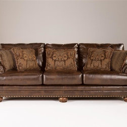 """Signature Design by Ashley - Faux Leather Sofa in Cafe Brown - Frames have been tested to GSA government standards. Corners are glued, blocked and stapled. Seats and back spring rails are cut from 7/8"""" hardwood. Stripes and patterns are match cut. All fabrics are pre-approved for wearability and durability against AHMA standards. Cushion cores are constructed of low melt fiber wrapped over high quality foam.. Color: Antique. Material: Faux Leather. 102 in. L x 40 in. W x 39 in. H (153 lbs)"""